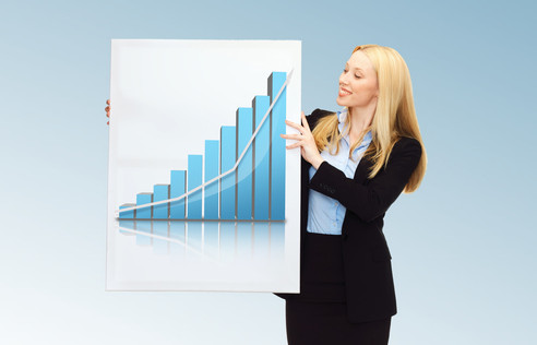 businesswoman holding board with graph